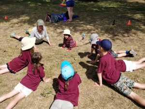 Diana Mello leads a kids yoga class.
